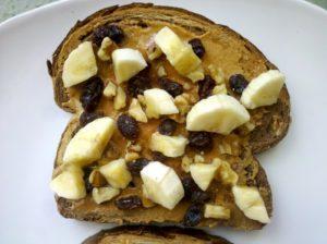 Easy Breakfast Ideas - Toast with peanut butter, raisins, walnuts and banana slices!